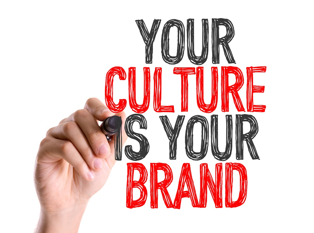 Hand with marker writing Your Culture Is Your Brand