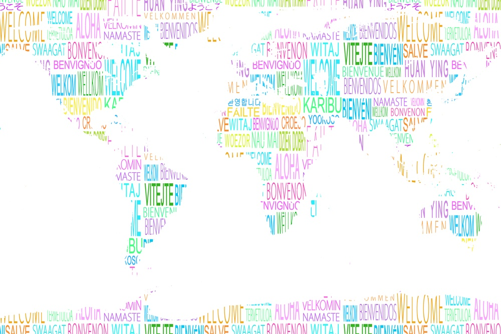 Map showing welcome in different languages on white background.jpeg
