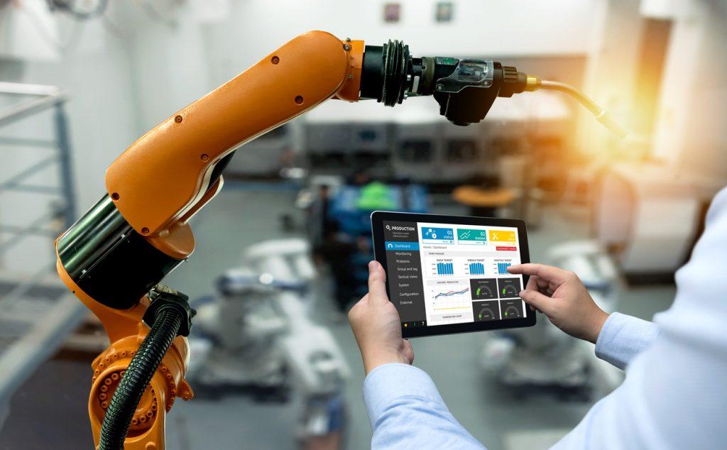 man using ipad robot arm automation